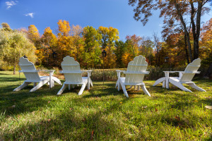 Adirondack Chairs Overlooking Pond & Fall Foliage